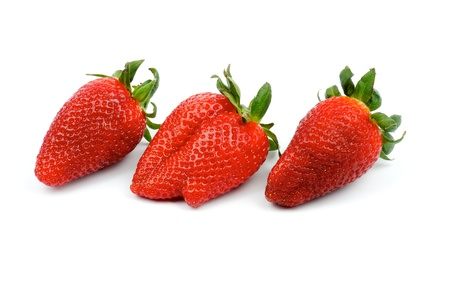 Three Perfect Big Strawberries In a Row isolated on white background photo