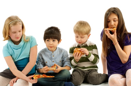 Two Boys and Two Girls Eating Pizza isolated on white background Stock Photo - 19562305