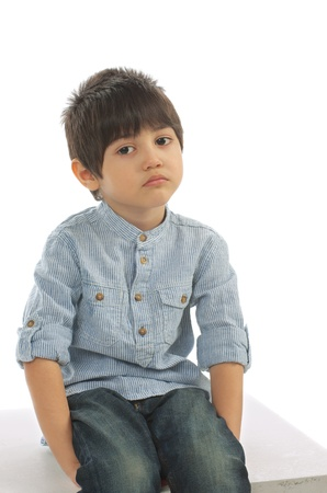 one little boy: Sad Little Boy in Striped Shirt and Jeans Stock Photo