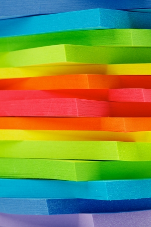 Stack of Rainbow Colored Post It Notes Stickers closeup as Background photo