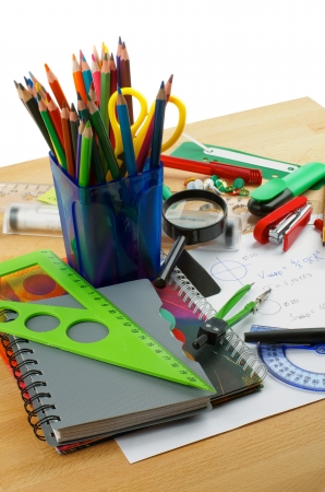 drawing compass: School Supplies with Note Pads, Pencils, Pens, Colored Pencils, Scissors, Pencil Sharpener, Buttons, Drawing Compass, Magnifier, Stapler, Slide-Rule and Ruler Lines on Edge of School Desk