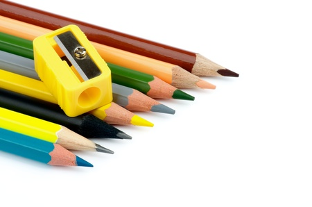 Arrangement of Sharp Lead and Colored Pencils with Pencil Sharpener isolated on white background photo