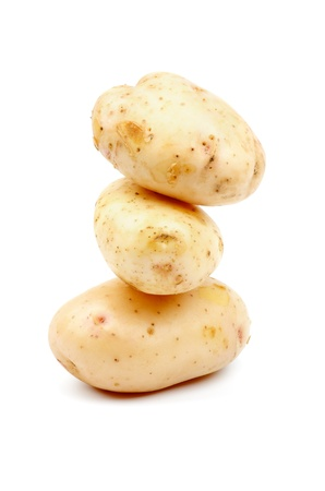 russet potato: Stack of Three Raw New Harvest Potato isolated on white background