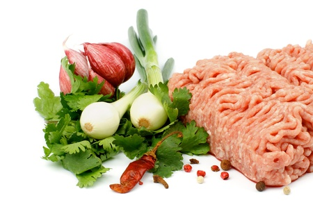 Raw Minced Meat with Parsley, Spring Onion, Garlic and Spices isolated on white background photo