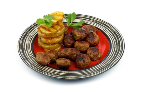 grilled potato: Delicious Roasted Meatballs and Stack of Grilled Potato with Greens on Red Striped Plate isolated on white background