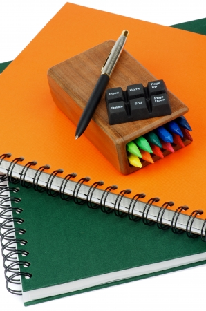 page down: Arrangement of Spiral Notebooks, Pen and Keyboard Buttons closeup Stock Photo