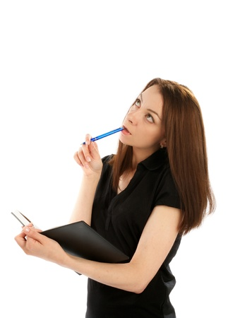 Young Attractive Business Woman with Pen and Organizer in her Hand Thinking  photo