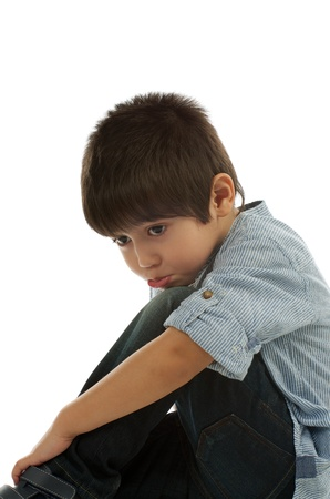 offended: Offended Little Boy in Striped Shirt closeup on white background Stock Photo