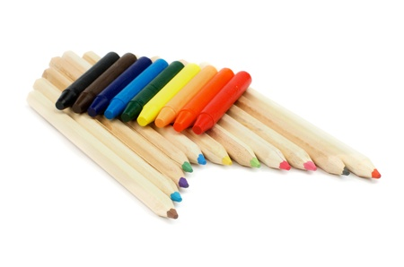 Arrangement of Wood Color Pencils and Rainbow Colored Crayon Chalks isolated on white background photo