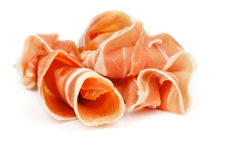 Curled Slices of Delicious Prosciutto isolated on white background