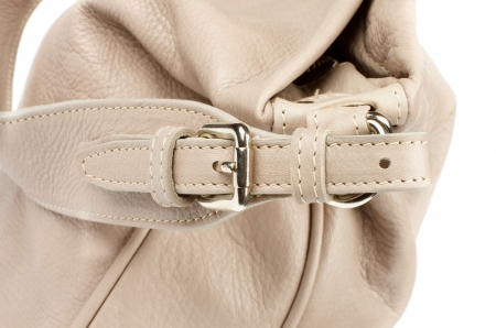 Beige Women Bag with Silver Rivets and Buckle isolated on white background Stock Photo - 21538623