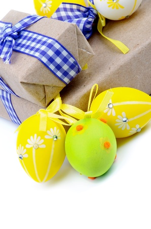 Arrangement of Gift Boxes with Ribbons and Easter Eggs isolated on white background photo