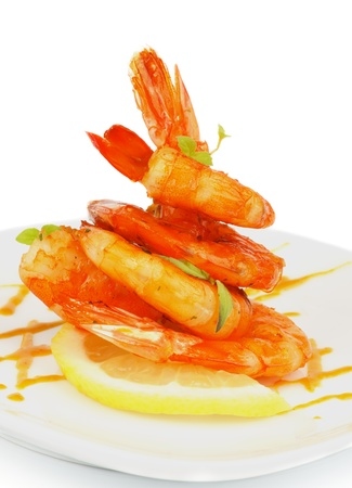 Delicious Fried Shrimps Decorated with Lemon, Mustard Sauce and Thyme closeup on White plate photo