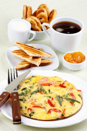 Arrangement of Delicious Omelet with Vegetables, Toasts, Apricot Jam, Cup of Coffee, Milk and Puff Pastry closeup on light green Checkered background Stock Photo - 22134018