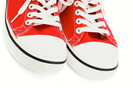 Two Trendy Red Gym Shoes closeup on white background photo