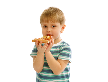 Little Cute Boy in Striped T-Short Eating Piece of Cheese Pizza isolated on white background photo