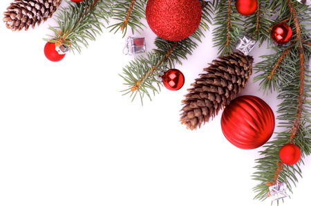 Frame of Christmas Decoration with Spruce Branch, Fir Cones, Red Baubles and Silver Gift Boxes isolated on white background