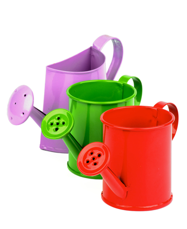 wateringcan: Arrangement of Red, Green and Purple Little Watering-Can isolated on white background Stock Photo