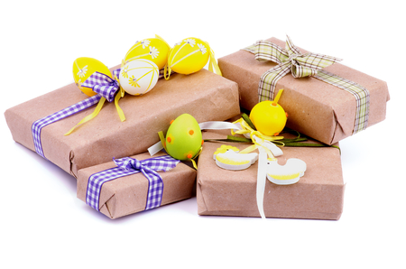 Heap of Gift Boxes in Wrapping Paper with Checkered Ribbons, Decorative Chickens and Easter Eggs isolated on white background Foto de archivo