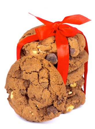 Stack of Delicious Christmas Chocolate Cookies Tied with Red Ribbon and Bow isolated on white background photo