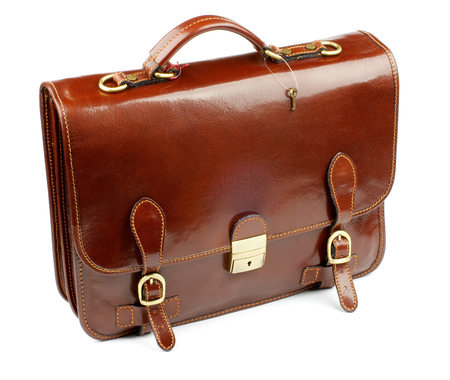 Luxury Brown Leather Briefcase closeup with Gold Details and Little Key isolated on white background Foto de archivo