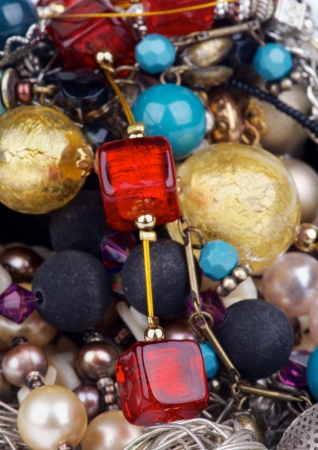 Background of Various Jewelry with Gold Bracelets, Ruby Necklace, Pearl and Gem Beads closeup photo
