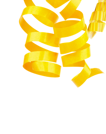 Three Yellow Hanging Curly Party Streamers isolated on white background photo