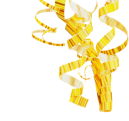 Arrangement of Striped Yellow Curly Hanging Party Streamers isolated on white background photo