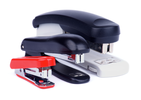 Three Staplers in a Rownisolated on white background  Side View Stock Photo - 23444015