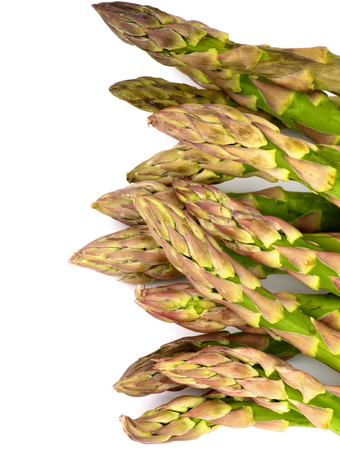 Frame of Fresh Raw Asparagus Sprouts isolated on white background. Stock Photo