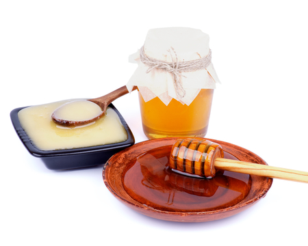a jar stand: Arrangement of Wooden Dipper with Honey into Brown Plate, Glass Jar with Flower Honey and White Honey Black Bowl with Wooden Spoon isolated on white background