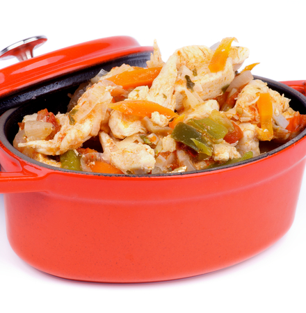 Homemade Chicken Breast Stew with Carrot, Leek and Bell Pepper in Orange Pot closeup  photo