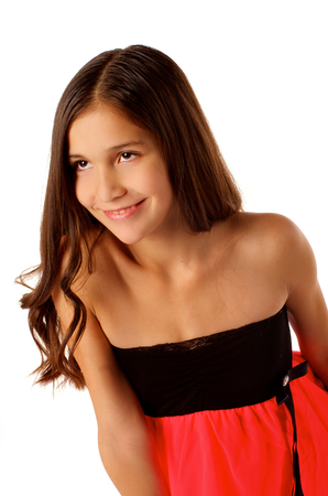 Cheerful Attractive Teen Girl with Long Beautiful Hair in Black and Pink Dress  isolated on white  photo