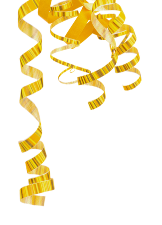 party popper: Corner of Striped Yellow Curly Hanging Down Party Streamers isolated on white background