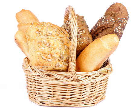 bread basket: Bunch of Freshly Baked Various Bread in Wicker Basket isolated on white background