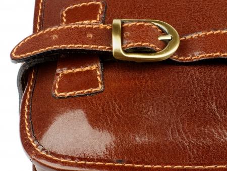 backstitch: Details of Ginger Leather Traveling Bag with Pocket Bronze Rivet and Backstitch closeup on white background
