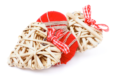 overlapped: Arrangement of Three Handmade Wicker and Textile Valentine Hearts Overlapped isolated on white background
