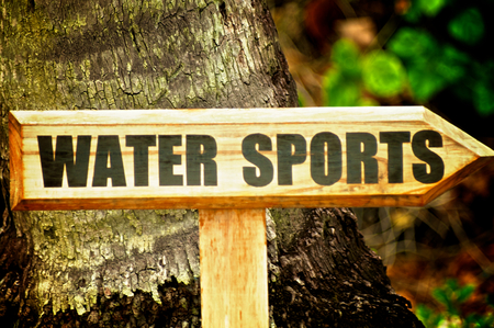 water sports: Wooden Sign Water Sports on Natural Environment background