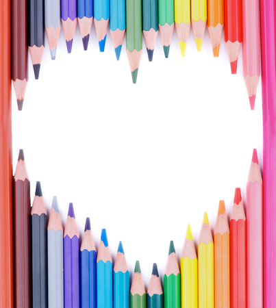 Shape Heart of Sharpened Multi Colored Pencils isolated on white background photo