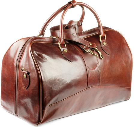 Big Ginger Leder-Reisetasche mit goldenen Details und Griffe isoliert auf weißem Hintergrund