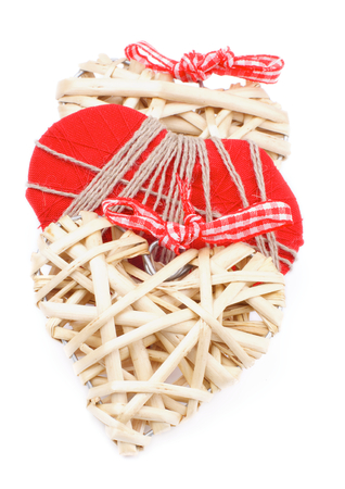 overlapped: Three Handmade Wicker and Textile Valentine Hearts Overlapped In a Row isolated on white background