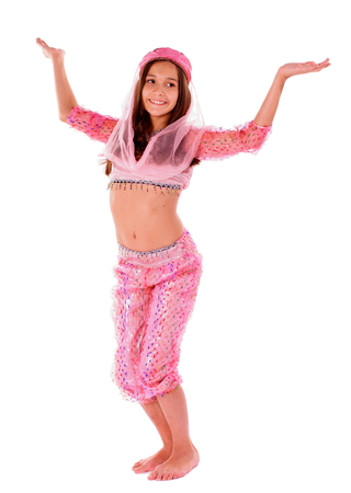 Young Girl Doing Dance Pose in Pink Oriental Costume on white background photo