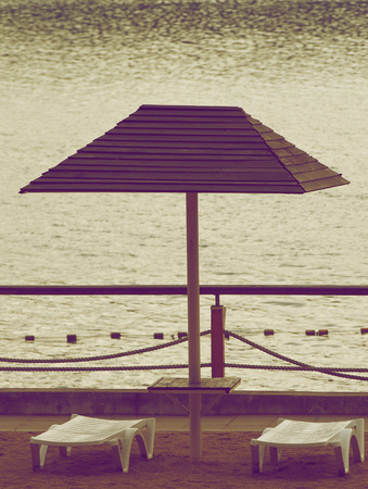 denominado retro: Beach Chairs and Parasol in Cloudy Day Outdoors  Retro Styled