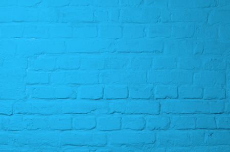 Background of Brick Wall Painted with Blue Mortar closeup photo