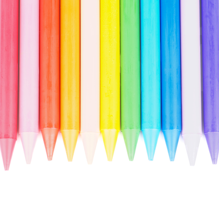 Border of Multicolored Polymeric Crayons isolated on white background. Top View photo