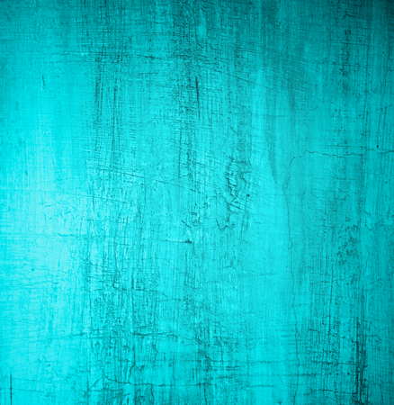 Turquoise Damaged Obsolete Cement Wall Background closeup photo
