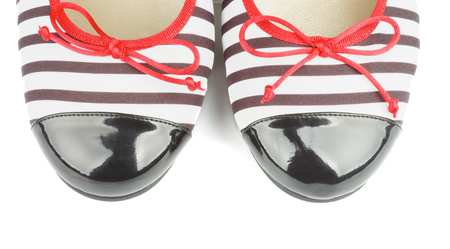 Noses of Striped and Varnished Elegant Women Shoes isolated on white background photo