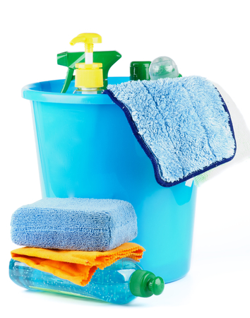 Arrangement of Cleaning Bottles and Sprays into Blue Bucket with Bath Sponge isolated on white background photo