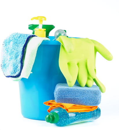 Arrangement of Cleaning Bottles and Sprays into Blue Bucket with Bath Sponge and Protective Gloves isolated on white background photo