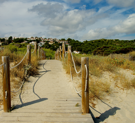 Boardwalk from Beach to Small Hill Town on Menorca, Balearic Islands photo